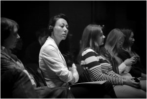 Colleen Montgomery listening to fellow presenters at the at the Aleksei Balabanov Conference in St. Petersburg (thanks for the conference's team of translators)