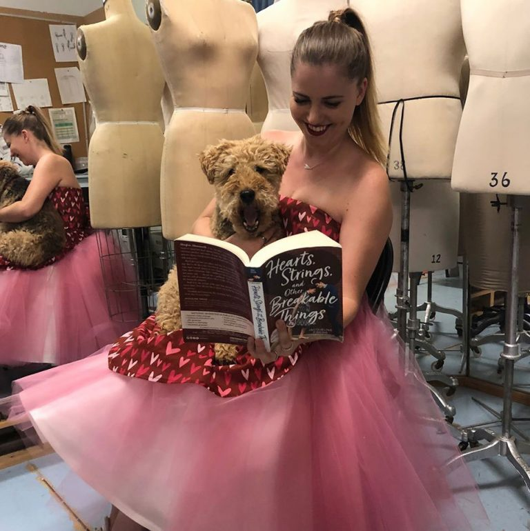 Jacqueline is combining her design and sewing skill with her writing expertise by offering a contest where readers can win a beautiful dress! One of them here is modelled by Theatre Design and Production Costume alumna, Nicolette Szabo, who is holding Ffiona, Jacqueline's favourite editor.